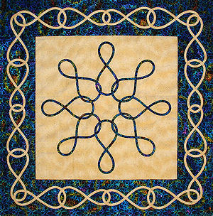 Infinity quilt design with a contrast border.
