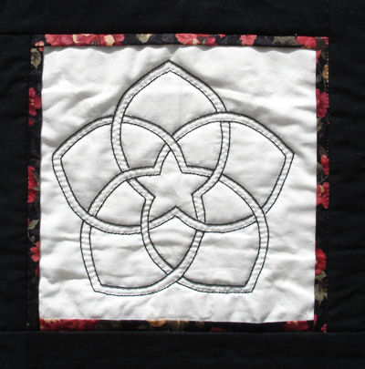 Closeup of the embroidered version of the Chinese flower block.