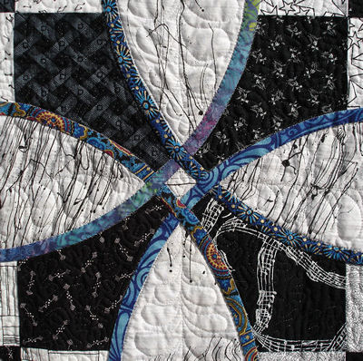 Close-up of a bias tape circle from the Knotwork Nine Patch quilt.
