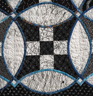 Close-up of one complete block from the Knotwork Nine Patch quilt.