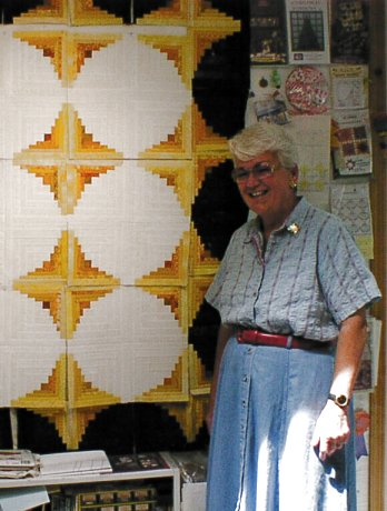[Mary Peard and her new quilt]