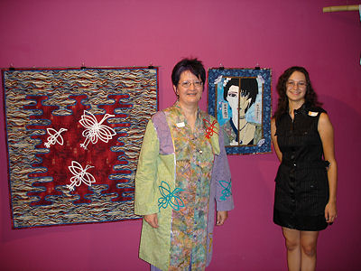 Scarlett and Heather at the Old City Hall Gallery with two of their quilts.