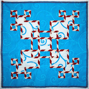 Celtic Circuits center block in new fabrics