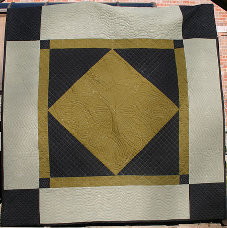 Mary Hansen's Amish quilt with Celtic quilting.