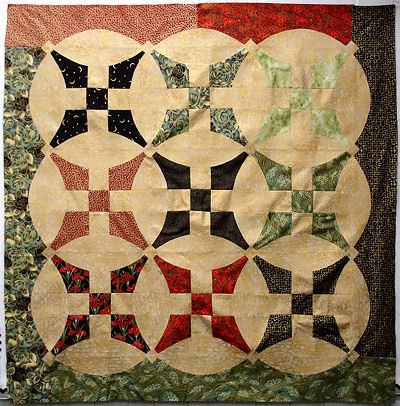 Sonya's gold and varigated quilt.