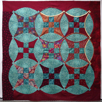 Sonya's red and turquiose quilt top.