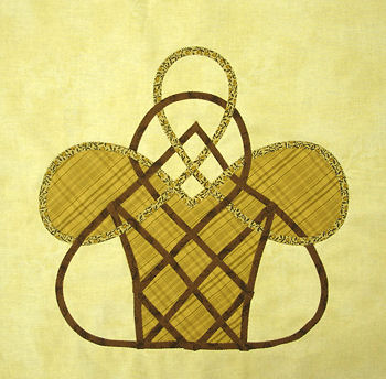 Celtic basket with plaid inset.